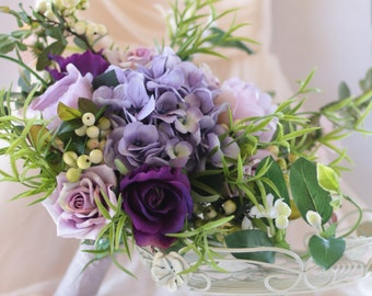 Purple wedding bouquet.  Roses, hydrangea, peony, berries and wild foliage. Silk bouquet, just picked from the garden, wedding flowers