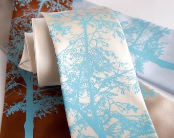 """Tree silhouette tie. """"Mountain Aspen"""" necktie. Sky blue print. Silkscreened 100% silk. Choose standard or narrow width."""