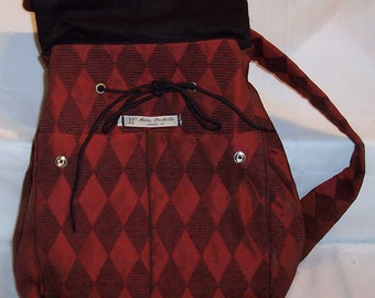 Clara Backpack in Burgundy Diamond Upholstery Fabric with black duck fabric lining