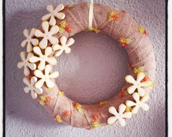 Wreath door, yellow flowers, orange and yellow beads and ribbons to hang