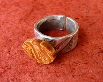 Original women ring, unique natural stone, jewel aluminum worked and textured, Adjustable ring, ocean Pebble, rust marbled