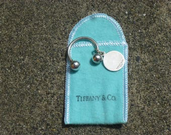 Authentic   T and CO......Tiffany and Company Keychahin in 925 silver.....Engravable  Keychain ....Rare....discountinured