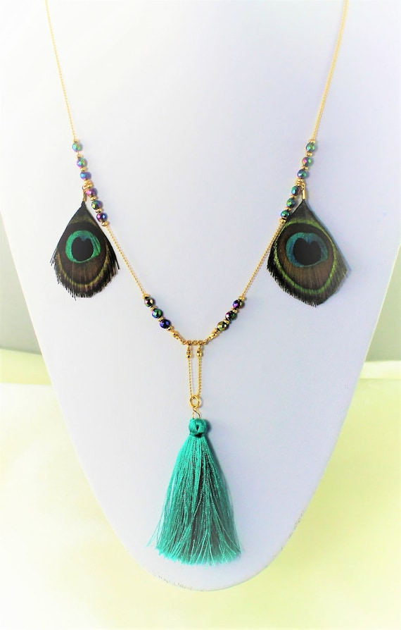 golden plated bohemian chic long necklace with peacock feather, blue tassel and rainbow hematite