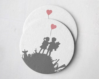 Banksy Drink Coasters – Absorbent Coaster Set of 10 – Coasters for Women & Men – Heavyweight Reusable Thick Pulpboard - Kids on Pile of guns