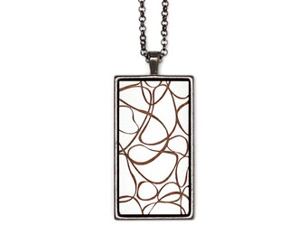 Customizable abstract table necklace. Cabochon pendant in metal and etched wood. Contemporary artistic jewel.
