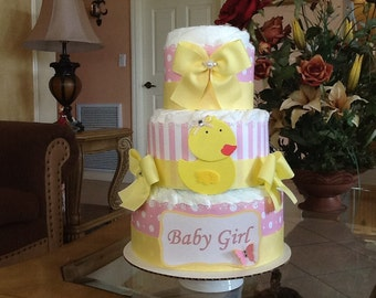 Rubber ducky diaper cake for baby girl's baby shower. Rubber ducky baby shower gift/centerpiece