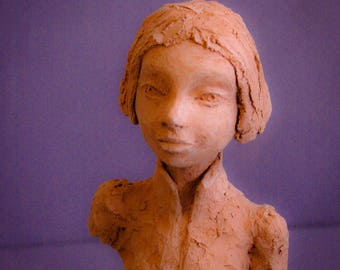 Luna, wise little girl:  Clay sculpture by Catherine Zivi