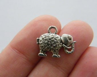 8 Elephant charms antique silver tone A496