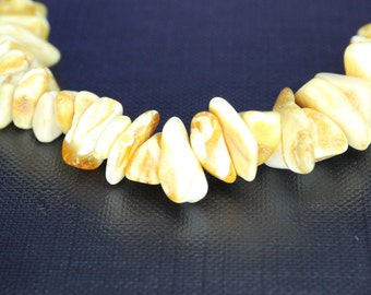 White amber bead