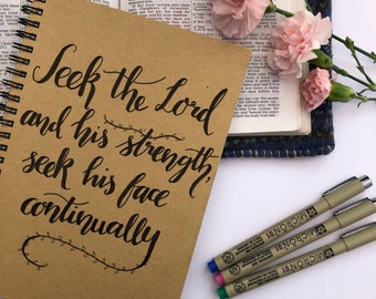 Spiral Bound A5 Kraft Notebook with a Hand Lettered Scripture Verse.