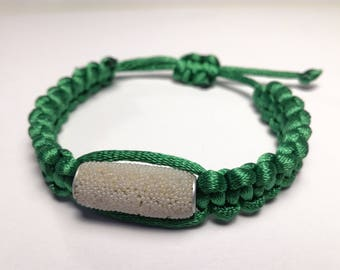 Green satin with long pearl bracelet