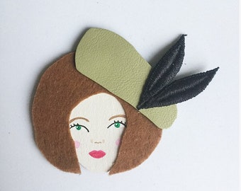 Calais lace brooch woman face with hat in green leather and feathers