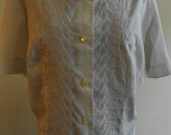 "1960's, 38"" bust, white cotton hip length eyelet , short sleeved blouse."