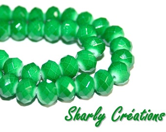 20 oval 8x6mm faceted dark green glass beads