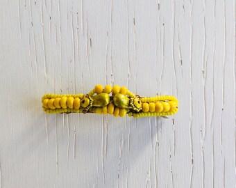 Small yellow barrette