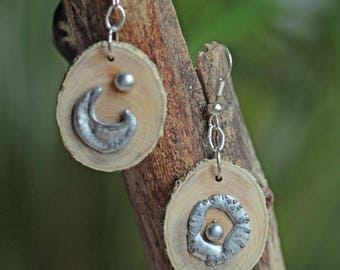 Reclaimed wood adorned with ornaments made Tin House earrings