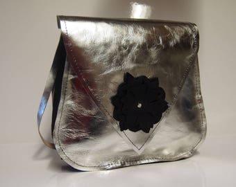 Silver colored leather shoulder bag.