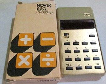 vintage, in original box with instructions and paperwork, NOVUS 850 personal CALCULATOR