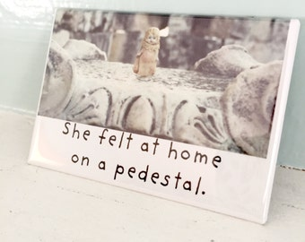 """Traveling Doll Typographic Magnet Claudia Dolly """"She Felt At Home On A Pedestal"""" Magnet"""