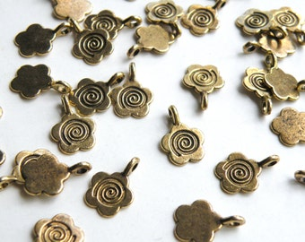 10 Flower glue on bails antique gold plated 15x11mm DB11245