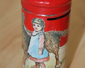 1977 Vintage Red Tin Coin Bank  featuring a Girl her Dog and her Cat