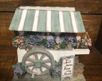 Vintage pfaltzgraff flower cart napkin holder. Sculpted resin.