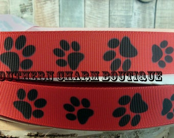 "3 yards of 7/8"" red with black paw prints grosgrain ribbon"