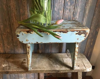 Delightfully chippy blue painted stool. A genuine country item for your vintage home