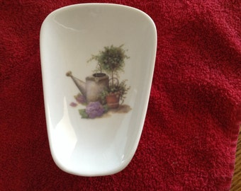 """Ceramic Spoon Rest with Topiary Silver Watering Can  5"""" Long and 3 1/2 inches With at Top of Spoon"""