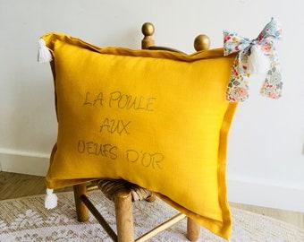 The hen in the golden egg yellow linen cushion