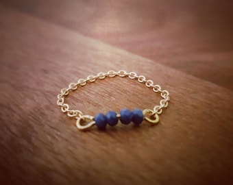 Ring links and blue beads