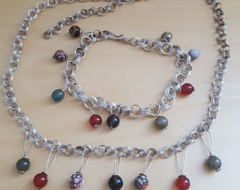 silver coloured necklace and bracelet with glass beads