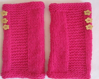 Pink mittens with flower buttons