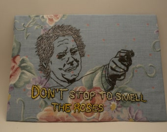Don't stop to smell the roses  hand embroidered onto 5x7 fabric, hand-embroidered Carol from TWD portrait, fan art