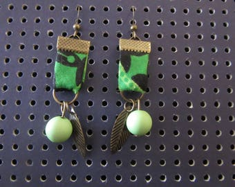 Earrings in green wax, assorted beads and leaf charms