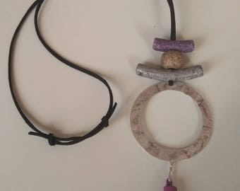 Necklace made by artificial suede cord, ceramic bead/bar, round silver antique pendant and suede tassel
