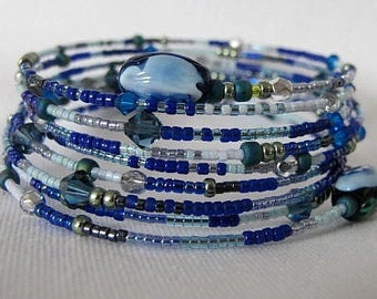 Blue Denim Gypsy wrap around bangle bracelet. Blue, navy, light blue, green, teal with millefiore bead ends. Cuff bracelet