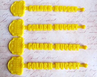 Vintage Golden Nugget Resort Swizzle Sticks Las Vegas Souvenirs Drink Stirrers Lemon Yellow