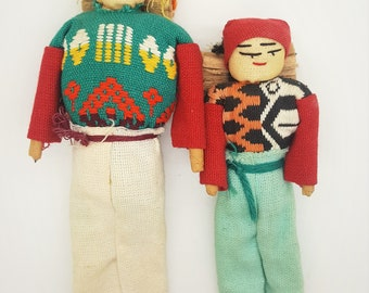 A pair of cultural folk art hand made stiched dolls Guatemala