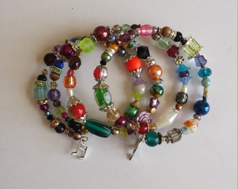 Bracelet 4 row memory wire - glass beads and multicolored acrylic