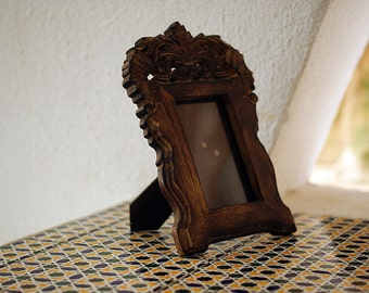 Old wooden frame for a photo.