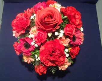 Red Rose and Carnation silk arrangement in red decorative container with gypsophila,  cherry blossom and anemones.