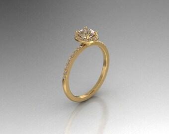 Elegant half carat round diamond halo engagement ring.