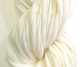 100 yards and 6.3 ounces/ 178 grams hand spun yarn, super bulky, in thick and thin natural cream merino wool