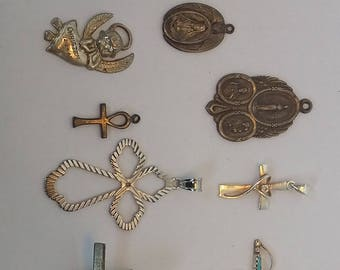 Eight Sterling Silver Religious Pendants and Pins