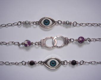 Bracelet with handcuffs or blue evil eye charm and beads