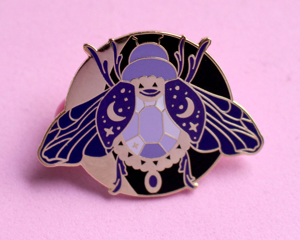 Moon beetle enamel pin