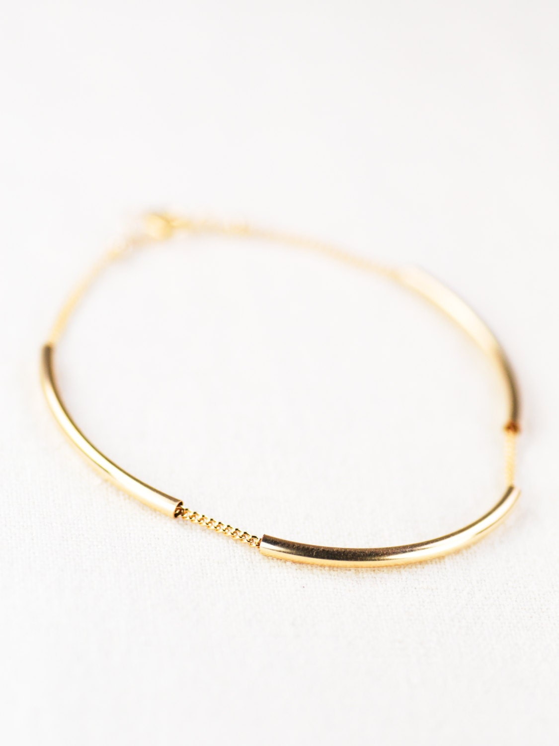 navy and seed filled pin delicate stack bracelet white bead in gold