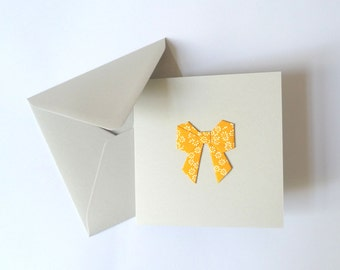 Origami bow card orange flowery paper