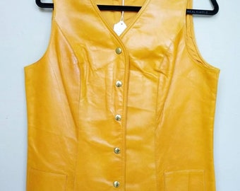 Groovy later 1960s/early 1970s Honey colored leather vest!  Snap front and full lining.